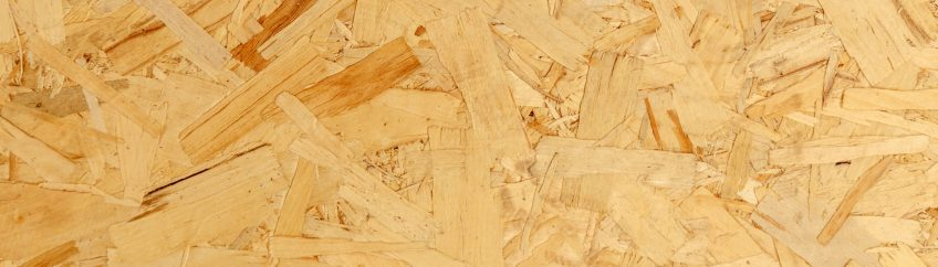 close up pressed wooden panel background texture of oriented strand board - OSB wood